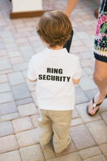 Ring Security :) How cute - & fun for the ring bearer. Sure way to make the little guy take his job seriously.