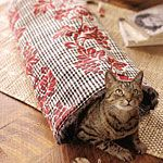 Easy-to-sew kitty tunnel.This fake fur-lined tunnel is the perfect location for feline mischief. #diy #crafts #sewing #cat #tunnel #cats
