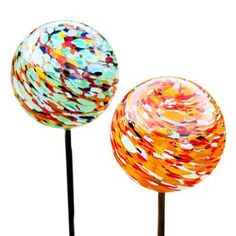 Solar Powered Garden Orb Lights. The beautiful solar-powered garden orb lights from Allsop Home & Design are hand-blown by glass makers and will lend your spring evenings a gentle and colorful glow.  $50.00