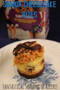 Samoa Cheesecake Bites | A cute little cheesecake dipped in chocolate and topped with caramel, coconut, and a drizzle of chocolate #dessert
