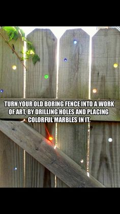 Add art to your fence by drilling holes and then placing colorful marbles in them