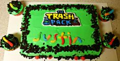 Trash Pack - Frozen image transfer of the Trash Pack logo. Used crushed oreos for dirt around the cake and gummy sour worms to spell out my sons name.