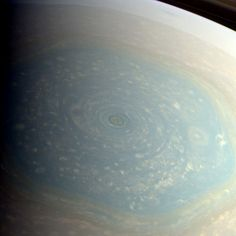 Color-composite image of Saturn's northern pole, made from raw Cassini images acquired Nov. 27, 2012, showing the central cyclone surrounded by the wider hexagonal jet stream feature, first spotted by Voyagers 1 and 2 thirty years ago.
