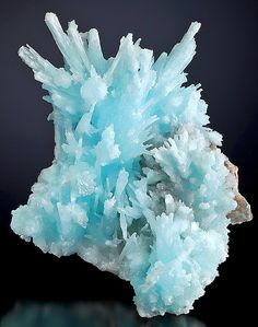 Lovely specimen of sky-blue Aragonite included by Aurichalcite :: From the Hunan Province of China.