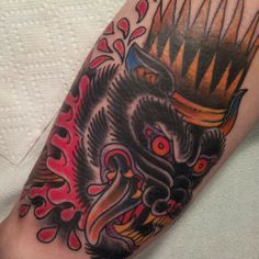 severed wolf head tattoo by Kate Collins