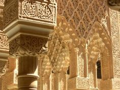 """Alhambra, Granada Spain  The literal translation of Alhambra, """"red fortress,"""" reflects the color of the red clay of the surroundings of which the fort is made. The buildings of the Alhambra were originally whitewashed; however, the buildings seen today are reddish."""