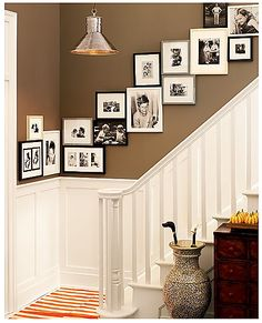 This completely solves the problem of hanging pictures on a straight plane! Definitely, if you have a space where you don't think one picture frame would look right, chances are several picture frames put together in a collage would work!....Love the wall color!