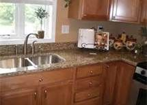 honey oak kitchen cabinets with black countertops - Bing Images