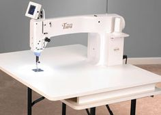 "Tiara, the latest addition to our royal quilting family, is a 16"" sit-down, longarm quilting machine!"
