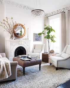 Cozy neutral and gray studio space. interior, white living, living rooms, elle decor, fireplac, light fixtures, keri russell, hous, live room