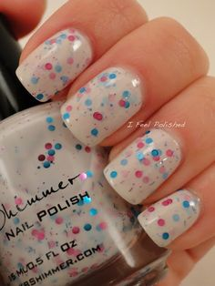 pink and blue spotted nail polish design