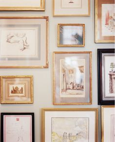 gallery wall with gold frames