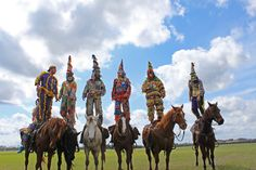 Riders stand on their mounts at the Cajun Courir de Mardi Gras, Church Point, La. Photo by Laura Gerdes Colligan