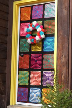 Yarn bombing the front door.