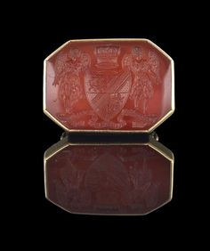 Robert Harley Earl of Oxford and Earl Mortimer Eighteen-Karat Yellow Gold Seal Ring, the octagonal-shaped carnelian intaglio engraved with a coat of arms and measuring approximately 31.0 mm x 22.0 mm, size 9-1/2, 14.6 grams total weight. $2460