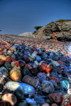 I want to know where this beach is - or one like it with the stones/pebbles - any ideas? - look at the colour of the beach stones!