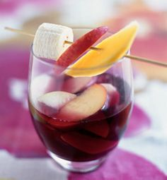 Fandango Sangria  Makes 20 servings    Ingredients  2 bottles of Spanish red wine   1/4 cup sugar   1 red apple, cored and sliced   1 green apple, cored and sliced   1 orange, cut into wedges   1 peach, cored and sliced   1 banana, peeled and sliced   1 mango, peeled and sliced   1 cinnamon stick   12 cloves (stuck into the citrus fruits or apples)   1.5 liters 7-Up    Combine all the ingredients, except the 7-Up, in a large ceramic or glass container and stir well. Cover and refrigerate for a...