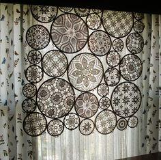 A beautiful way to use the doilys my mom has made.  Credit: Woolly Fabulous via Ajoure Blog [http://ajoureblog.com/2011/04/17/crochet-hoop-window-display/]