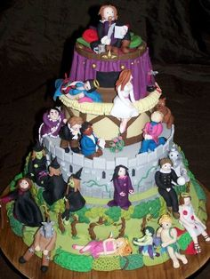 Shakespeare sits atop a cake of his work