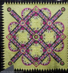 Shape Shifter by Nancy C. Arsenault. The New York Beauty blocks and sashing patterns are by Sue Garman.  2014 Road to California, photo by Quilt Inspiration