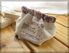 No pattern, just an idea: Use a gathered casing for a Snap Bag.