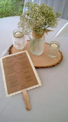 Rustic Wedding centerpiece and program...I know it says rustic...what about mason jars...can we do anything with mason jars??? maybe not a mason jar with flowers...can we make a mason jar candle as a something???