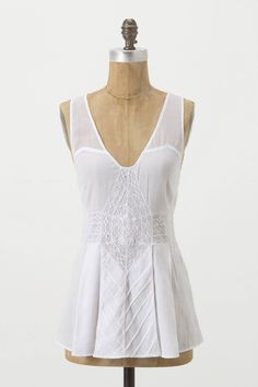 "Inset with openwork and silk, and rife with textural pintucks, this femme tank was inspired by a collection of vintage lace pieces. By Fleurette. - Cotton - Hand wash - 26""L - Imported"