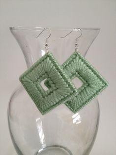 Plastic canvas diamond earrings with a hole.