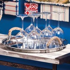 """Stainless steel tray with rope handles.  Product: Serving trayConstruction Material: Stainless steel and ropeColor: SilverDimensions: 1.5"""" H 17"""" Diameter  Note: Glasses not included"""