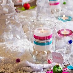 Candle + glass hurricane jar + giant pearl gumballs + pretty ribbons = our fave table detail for the holidays!
