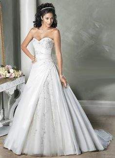 white wedding dress with opened shoulders