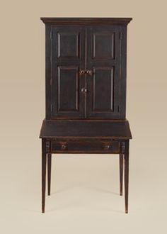 Primitive Secretary Desk with a primitive painted finish.