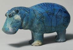 This well-formed statuette of a hippopotamus demonstrates the Egyptian artist's appreciation for the natural world. It was molded in faience, a ceramic material made of ground quartz. Beneath the blue-green glaze, the body was painted with the outlines of river plants, symbolizing the marshes in which the animal lived.