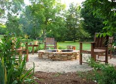 beautiful stacked stone fire pit.