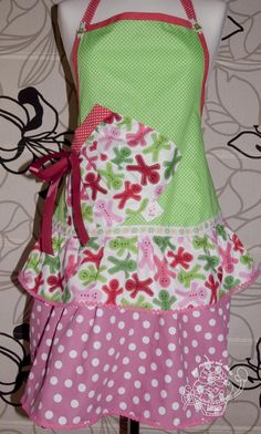 Make an adorable christmas apron. This fabric from Modes4U.com make the perfect Christmas sewing craft!