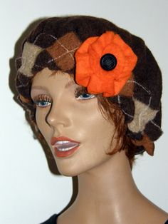 Chocolate Brown felted hat with a large orange  felted flower as decoration. Made from a large men sweater
