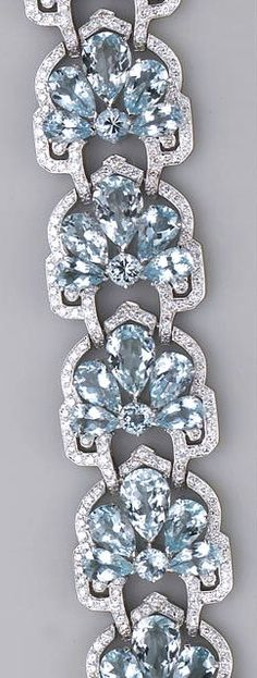 An aquamarine, diamond and eighteen karat white gold bracelet the flexible bracelet designed in a stylized fan motif, set with circular and pear-shaped aquamarines, framed by round brilliant-cut diamonds; aquamarines weighing a total of 48.78 carats; length: 7in.