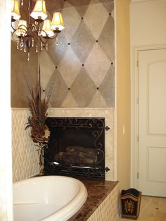 Custom painting adds a finished look to this cozy master bath.  The harlequin pattern and nailheads (at the all the points) add just the right finishing touches.