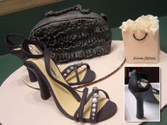 Purse is a try at a Choo purse. White cake with buttercream and covered in fondant. Shoes and shopping bag are gumpaste.