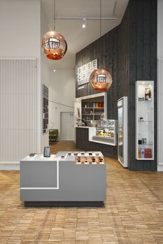 NEST ONE have designed BASE_camp, a mobile phone shop, café, co-working space, workshop and event location in Berlin, Germany.