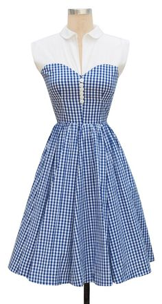 Such a cute gingham dress!  With the white yoke and collar, it looks like a fabulous 1950s picnic dress!