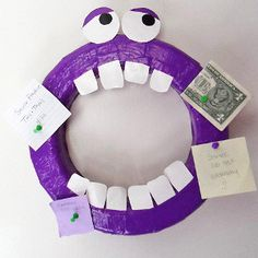 Monster Wreath Organizer - get organized with adorable Halloween crafts for kids. This silly guy can stay up year round, and he's so simple to make.