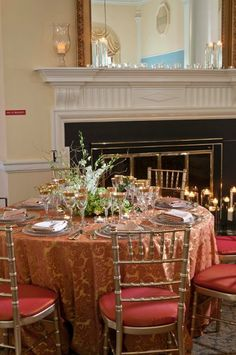 A glamorous wedding reception table setting at the McLean Gardens Ballroom! We love the touch of gold on the glasses! {McLean Gardens Ballroom}