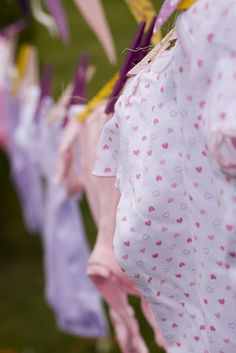 Lilac's and lemonade baby shower birthday party idea. Hanging onesie garland. See more at www.karaspartyideas.com