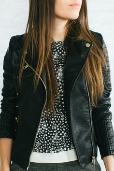 black + white top and leather jacket