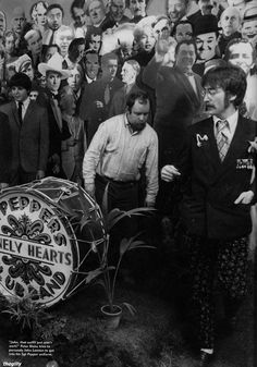 Peter Blake and John Lennon behind the scenes at the Sgt Pepper cover shoot. March 30, 1967.