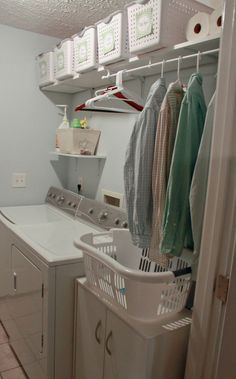 Nicely labeled baskets lining the top of the Laundry Room