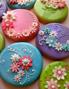 colorful flowers, clays, flower cookies, cakes, decorated cookies, polymer clay, fondant flowers, cupcake toppers, iced cookies