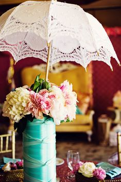 umbrella centerpiece // photo by Weddings by Scott and Dana // florals by Layers of Lovely // View more: http://ruffledblog.com/cookie-decorating-bridal-shower/