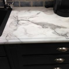 """Coffee, Tea, and Marble, on a Budget by Aristokraft - Formical 180FX has a 60"""" repeat pattern and is the most realistic marble imitation that you can find----but no etching! 180fx® by Formica Group. Free samples: http://www.formica.com/en/us/products/180fx"""